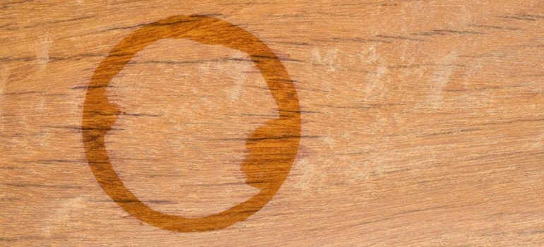 How to remove white stains from wooden tables.