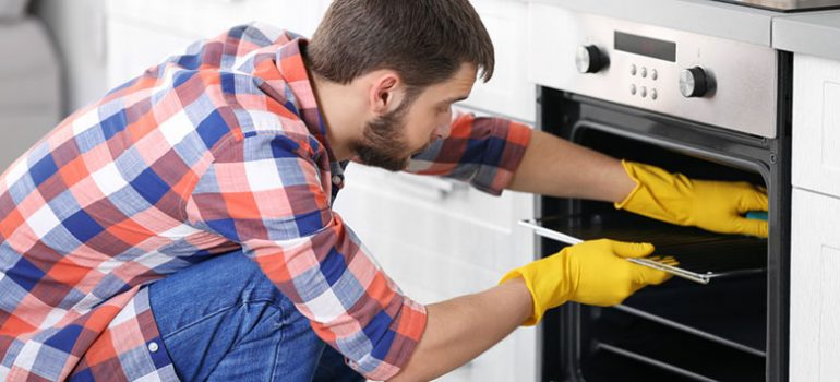A guide on cleaning dirty oven racks with aluminum foil.