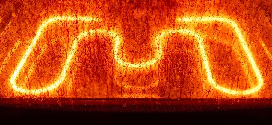 A glowing heating element of an oven during the self cleaning cycle.
