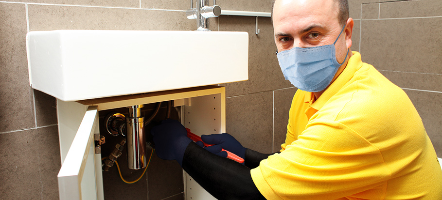 Plumber with protective gear