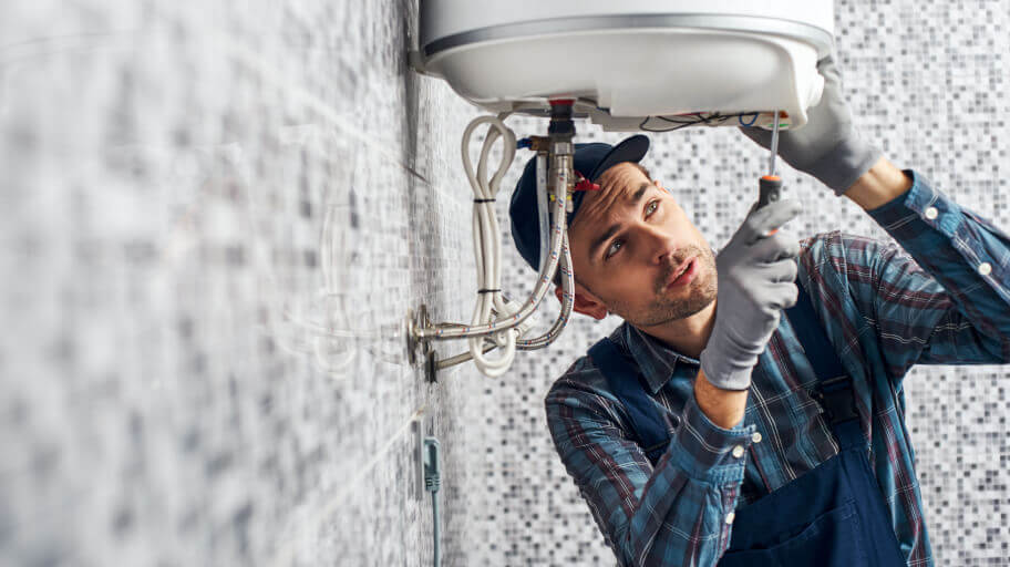 technician repairing faulty boiler