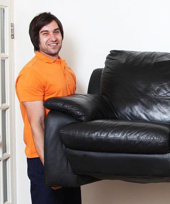 Fantastic Removals pro holding a sofa