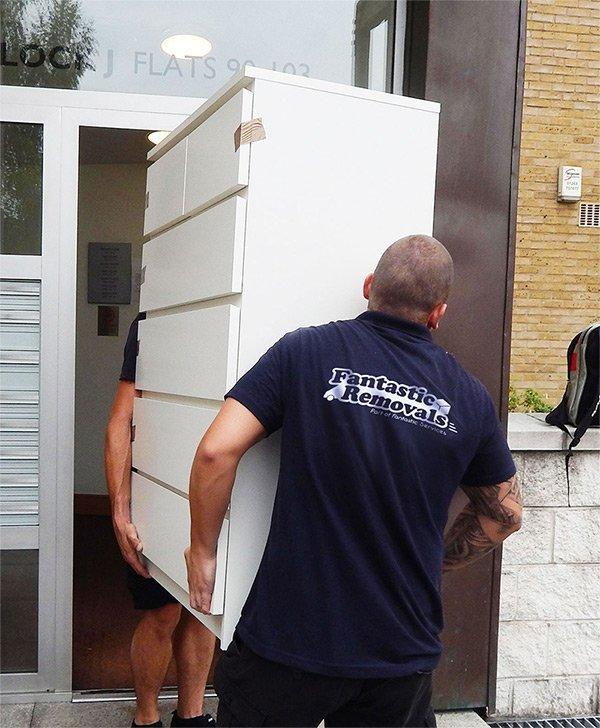 2 men moving a dresser
