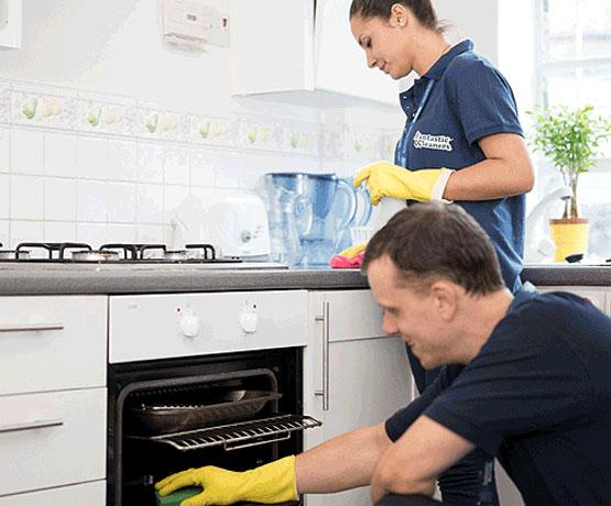 A team of 2 pros cleaning a kitchen